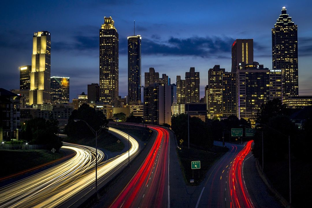Timelapse photo of a City Interstate and Skyscrapers at Night
